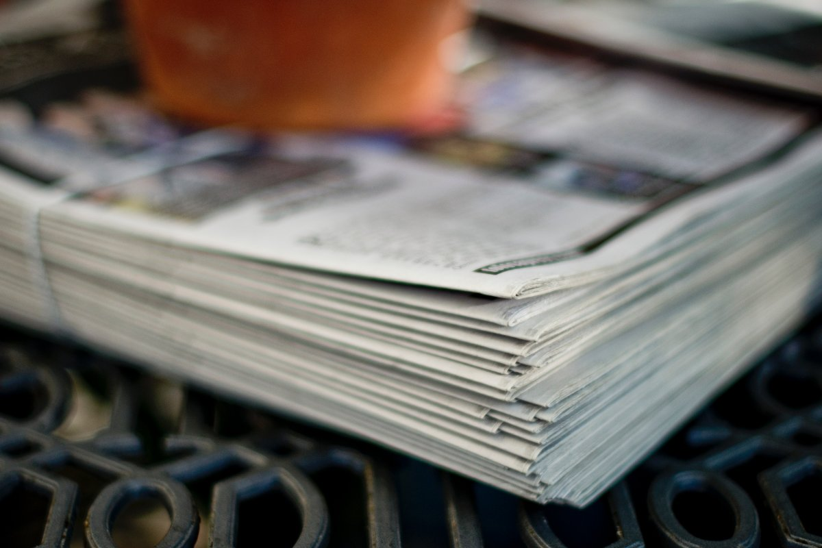 Photo by Tim Mossholder on Unsplash Pile of newspapers