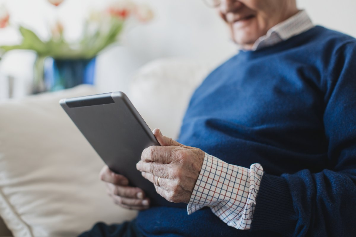 Older man reading from an IPad
